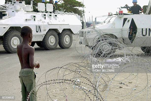 Chinese police of the UN peacekeeping force patrol a street in the Cite Soleil slum of PortauPrince 16 February 2005 Haiti's electoral process is...