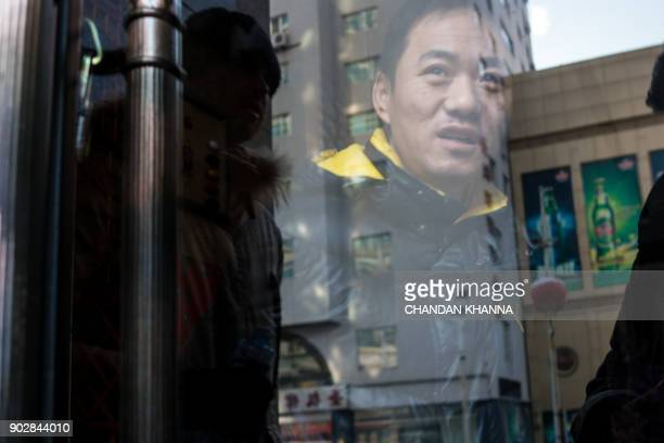 A Chinese police officer guards a closed North Korean restaurant in Dandong in China's northeast Liaoning province on January 9 2018 Some North...