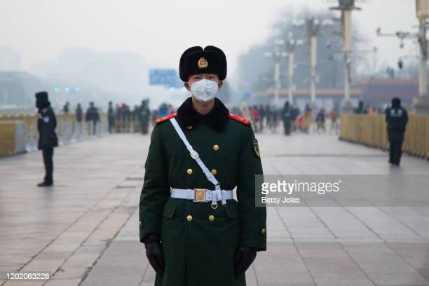 Chinese police officer wearing a mask stands in front of the Tiananmen Gate on January 26 2020 in Beijing China The number of cases of coronavirus...