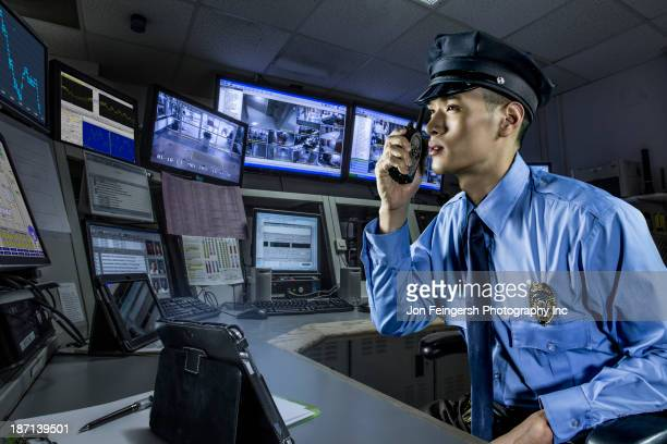 chinese police officer working in control room - watchmen stock pictures, royalty-free photos & images