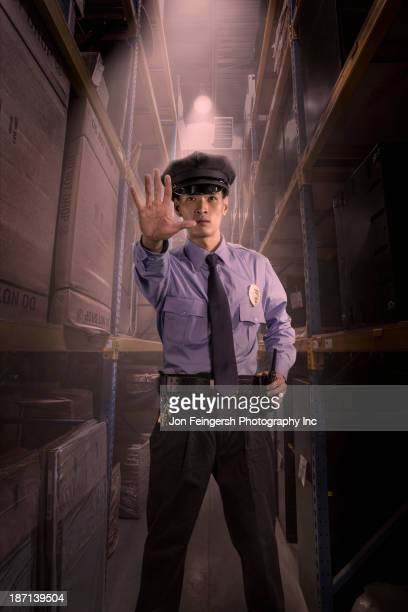 Chinese police officer working in warehouse