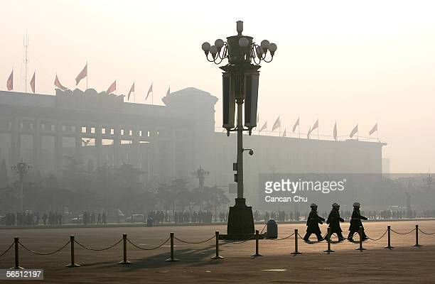 Chinese police officers patrol Tiananmen Square during fog on January 1 2005 in Beijing China According to a recent survey Beijing does not rank in...
