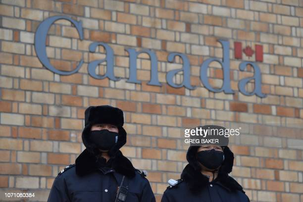 Chinese police officers stand guard outside the Canadian embassy in Beijing on December 10 2018 China on December 10 protested Canada's inhumane...