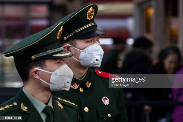 Chinese police officers wear protective masks at Beijing Station before the annual Spring Festival on January 22, 2020 in Beijing, China. The number...