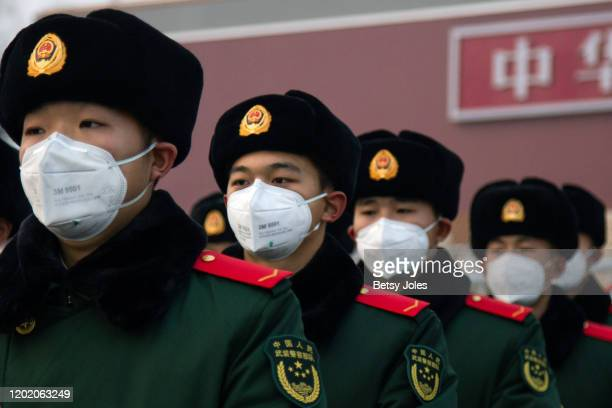 Chinese police officers wearing masks stand in front of the Tiananmen Gate on January 26, 2020 in Beijing, China. The number of cases of coronavirus...