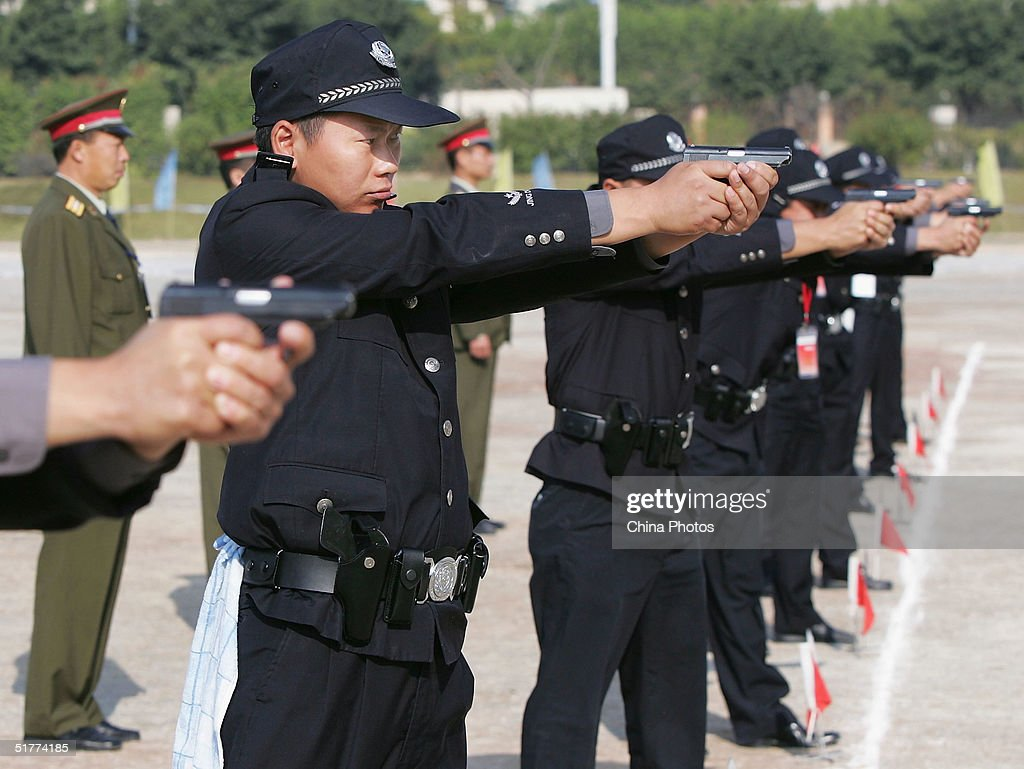 Chinese police participate in a training exercise on November 21, 2004 in Guangzhou, China. Hundreds of police and border guards from China's southern province of Guangdong took part in the exercise as part of efforts by local authorities to beef up security.