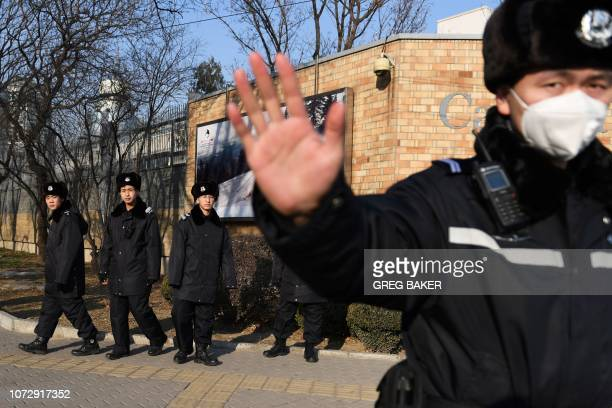 Chinese police patrol in front of the Canadian embassy in Beijing on December 14 2018 China confirmed on December 13 that two Canadians are under...