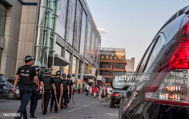 CONTENT] Chinese police patrolling the streets Urumchi China 2013