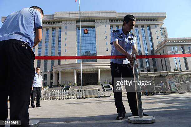 Chinese police set up a cordon outside the courthouse in Xian northern China's Shaanxi province on August 30 as Yang Dacai dubbed 'Brother Watch' by...