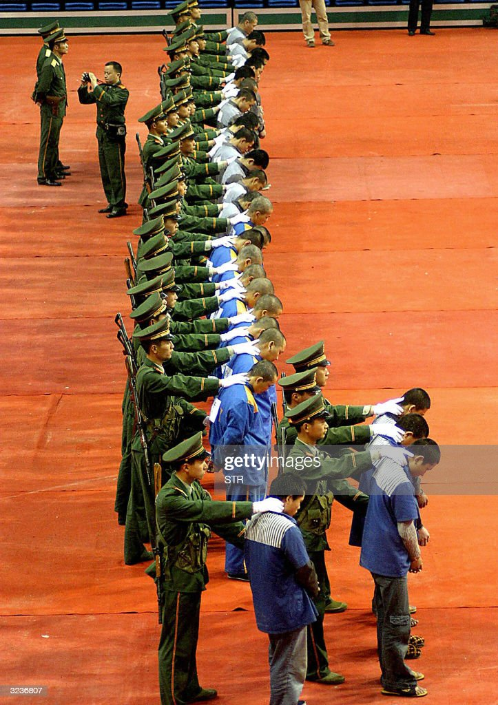 Chinese police show of a group of hardcore convicts at a sentencing rally in the east Chinese city of Wenzhou, 07 April 2004, where 11 prisoners were later excuted for various crimes. Amnesty International has called for a moratorium on the death penalty in China, saying the country's dysfunctional criminal justice system meant many innocent people were being executed, after a senior Chinese legislator suggested China executes at least 10,000 people a year, about five times more than the rest of the world combined.
