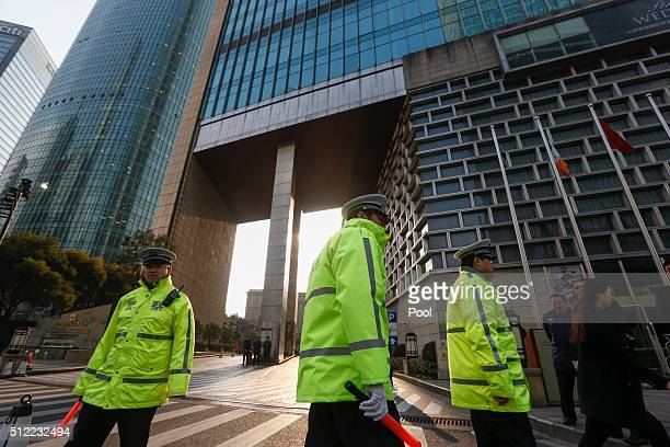 Chinese police stand guard ahead of the G20 Finance Ministers and Central Bank Governors Meeting at the Pudong Shangrila Hotel on February 25 2016 in...
