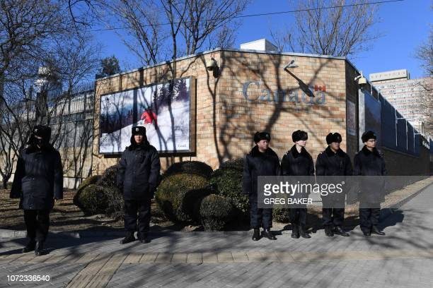 Chinese police stand guard in front of the Canadian embassy in Beijing on December 13 2018 A second Canadian who had gone missing in China is under...
