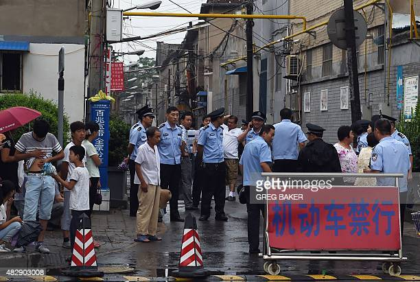Chinese police stand guard outside the street leading to the Sacred Heart of Jesus Catholic church where Father Joseph Zhang Yilin was being ordained...