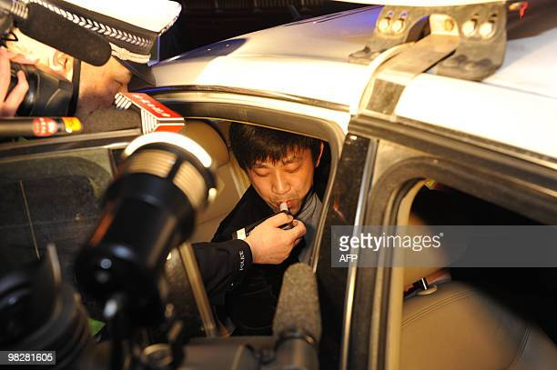 Chinese police uses a breathalyzer test on a car driver suspected to be intoxicated in Beijing on April 3 2010 China's roads are among the most...