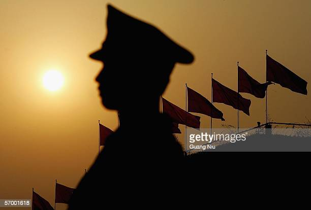 Chinese policeman guards at Tiananmen Square during the opening ceremony of the National People's Congress China's parliament on March 5 2006 in...