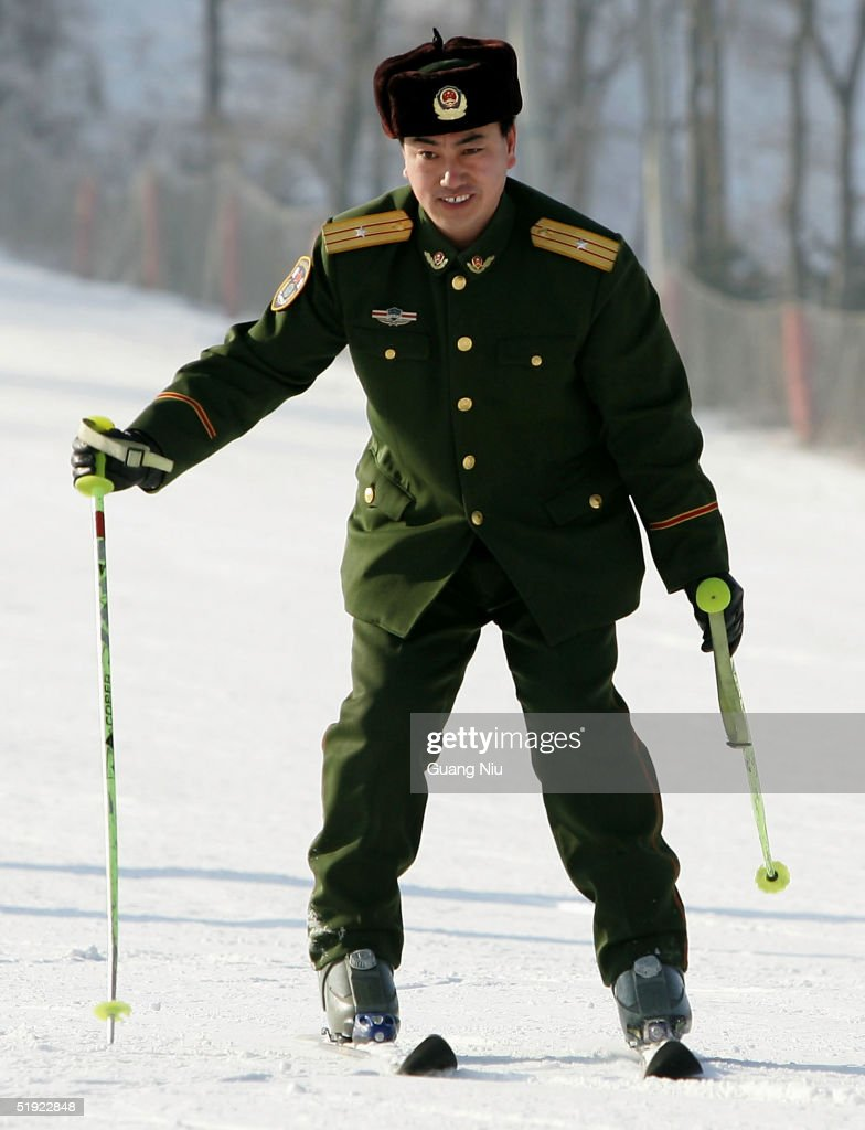 A Chinese policeman learns to ski at a skiing resort on January 7, 2005 in Harbin, China. Local authorities are preparing to bid for the 2014 Winter Olympic Games despite losing the bid to host the 2010 winter games.