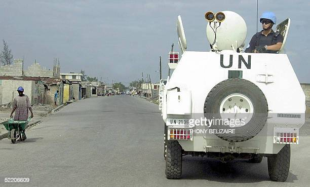 Chinese policeman of the UN peacekeeping force patrols the Cite Soleil slum of Port-au-Prince 16 February 2005. Haiti's electoral process is under...