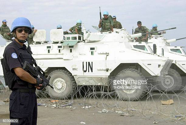 Chinese policeman of the UN peacekeeping force surveys the dock at the Cite Soleil slum of Port-au-Prince 16 February 2005. Haiti's electoral process...