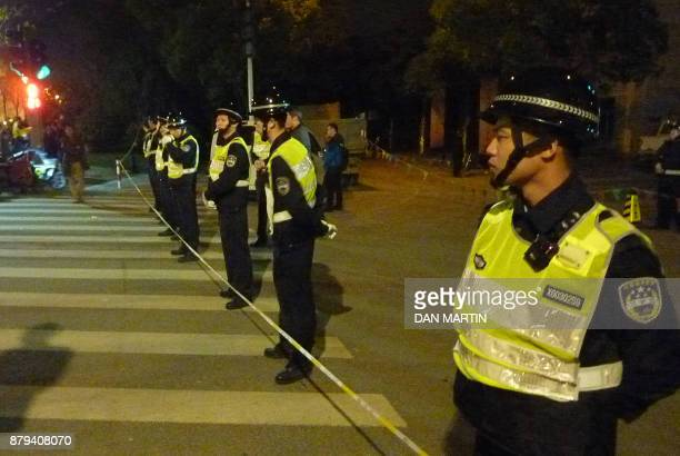 Chinese policemen control the road at the site of an explosion in Ningbo in the eastern Zhejiang province on November 26, 2017. An explosion so...