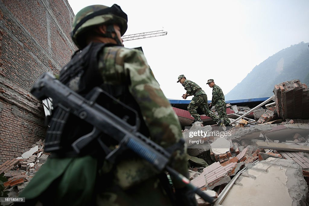 Chinese policemen look for the earthquake survivors on April 22, 2013 in Baoxing county of Ya An, China. A magnitude 7 earthquake hit China's Sichuan province on April 20 claiming over 190 lives and injuring thousands.