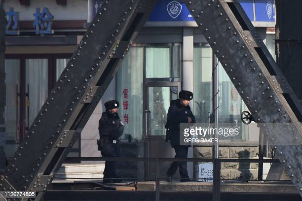 Chinese policemen patrol at the customs checkpoint on the Sino-Korean Friendship Bridge, which spans the Yalu River between China and North Korea, in...