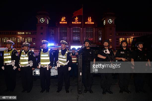 Chinese policemen take up position during a drill outside the railway station in Beijing on the early hours of May 2 2014 Chinese President Xi...