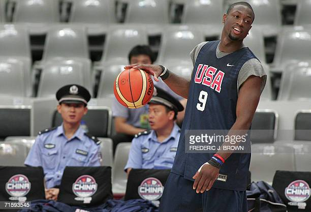 Chinese policemen watch from the stands as NBA star Dwyane Wade of the Miami Heat takes to the court during a USA training session in Guangzhou 06...