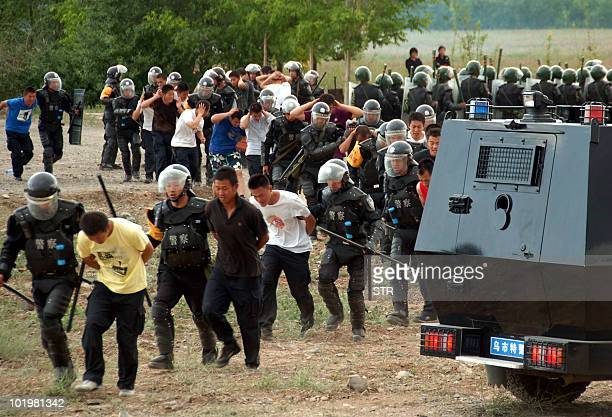 Chinese police's anti-riot squads, special forces and paramilitary police show off how they deal with any unrest during joint exercises in Urumqi,...