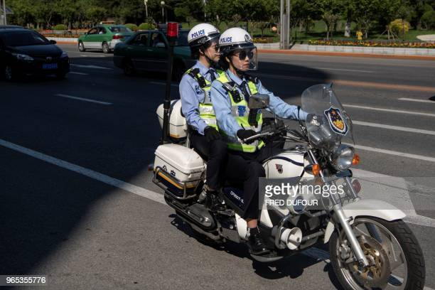 Chinese policewomen patrol in the streets of the Chinese border town of Dandong in China's northeast Liaoning province on May 31 2018 The city of...