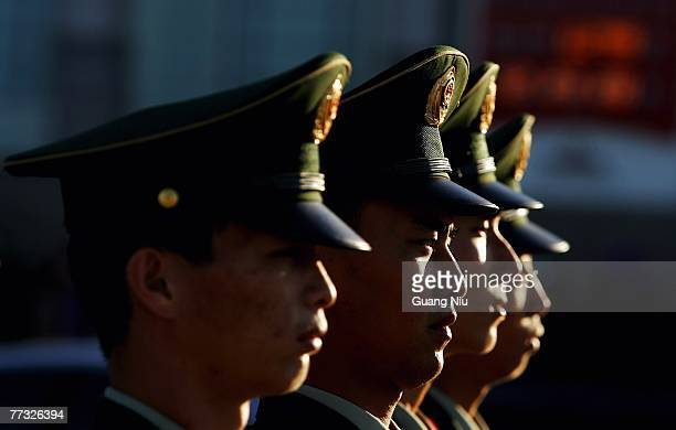 Chinese policmen stand at Tiananmen Square ahead the opening session of the five-yearly Chinese Communist Party Congress on October 15, 2007 in...