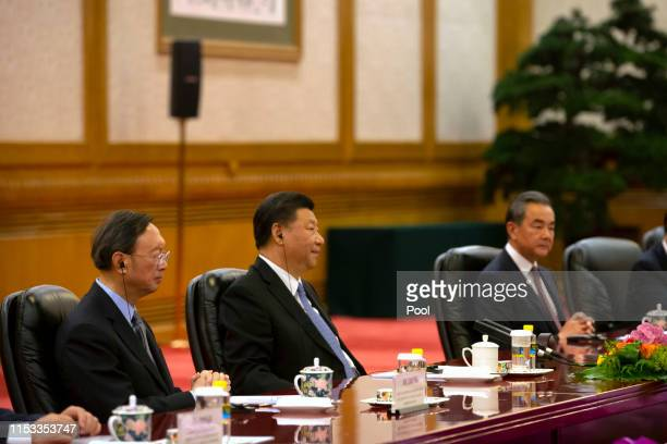 Chinese Politburo Member Yang Jiechi, Chinese President Xi Jinping and Chinese Foreign Minister Wang Yi listen as Bulgarian President Rumen Radev...