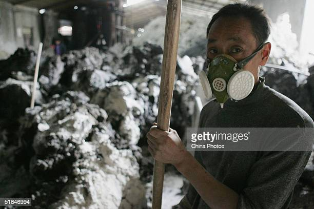 A Chinese potter works at a ceramic tile factory on December 1 2004 in Wenzhou Zhejiang Province of China Some workers are suffering from the...
