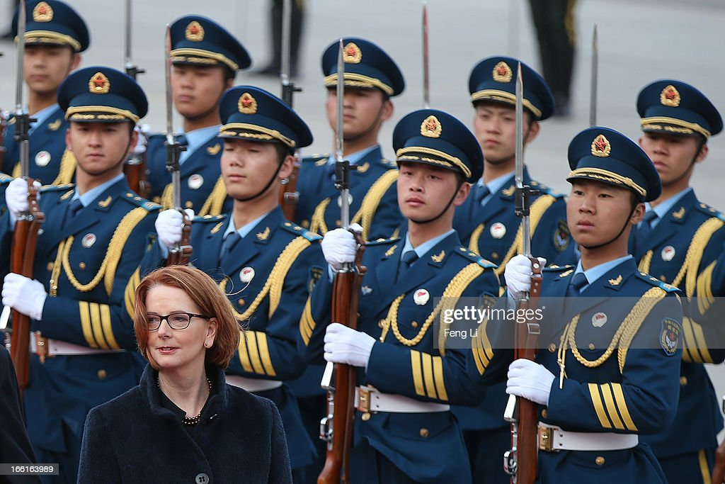 Chinese Premier Li Keqiang accompanies Australian Prime Minister Julia Gillard (Below) to view an honour guard during a welcoming ceremony outside the Great Hall of the People on April 9, 2013 in Beijing, China. At the invitation of Chinese Premier Li Keqiang, Australian Prime Minister Julia Gillard will pay an official visit to China after the Boao Forum for Asia Annual Conference 2013.