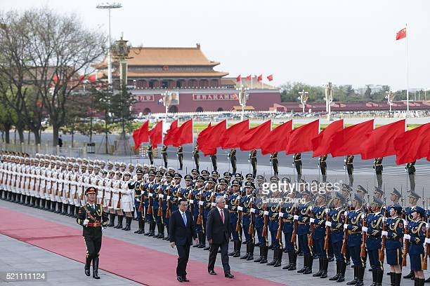 Chinese Premier Li Keqiang accompanies Australian Prime Minister Malcolm Turnbull to view a guard of honour during a welcoming ceremony outside the...
