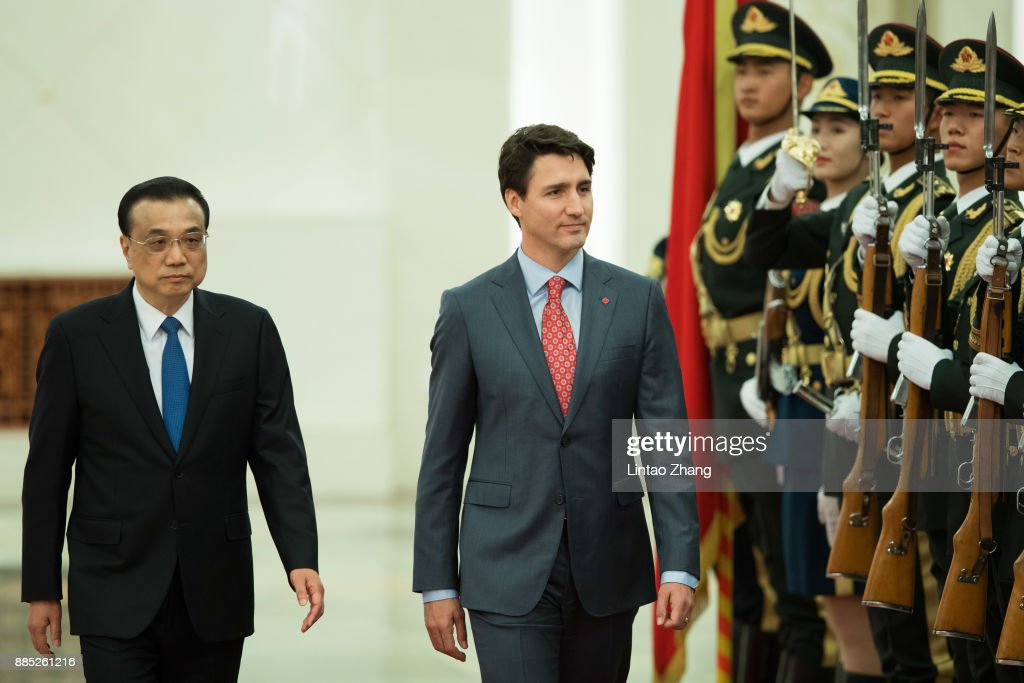 Chinese Premier Li Keqiang (L) accompanies Canada's Prime Minister Justin Trudeau (R) to view an honour guard during a welcoming ceremony inside the Great Hall of the People on December 4, 2017 in Beijing, China. At the invitation of Premier Li Keqiang of the State Council of China, Prime Minister of Canada, Justin Trudeau will pay an official visit to China from Dec 3 to 7.