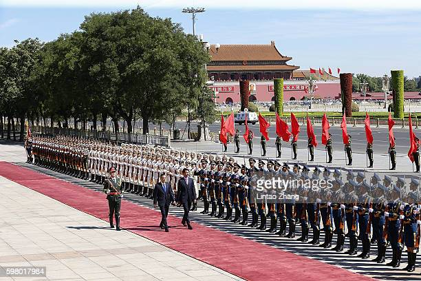 Chinese Premier Li Keqiang accompanies Canadian Prime Minister Justin Trudeau to view an honour guard during a welcoming ceremony outside the Great...