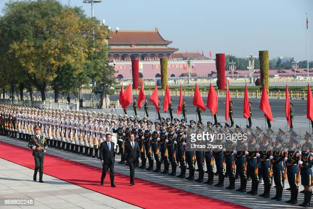 Chinese Premier Li Keqiang accompanies Russia's Prime Minister Dmitry Medvedev to view an honour guard during a welcoming ceremony outside the Great...