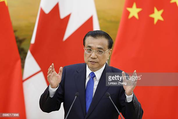 Chinese Premier Li Keqiang addresses a press conference with Canadian Prime Minister Justin Trudeau at the Great Hall of the People on August 31,...