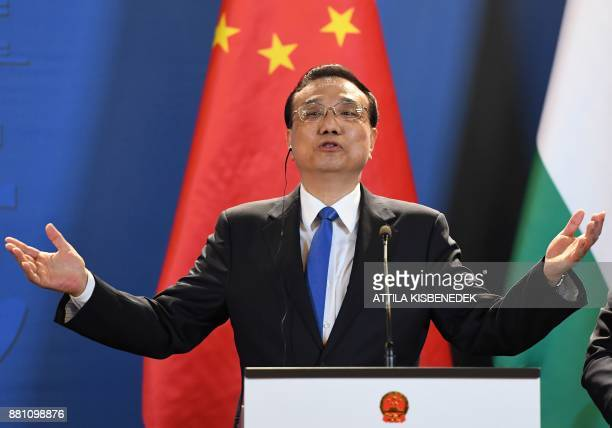 Chinese Premier Li Keqiang addresses a press conference with the Hungarian Prime Minister in the Hungarian parliament building in Budapest on...