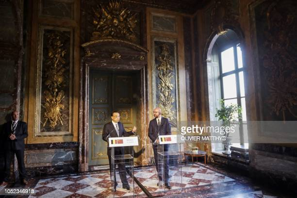 Chinese Premier Li Keqiang and Belgian Prime Minister Charles Michel give a joint press conference after their meeting during Keqiang's visit to...