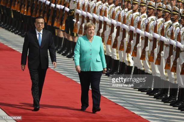 Chinese Premier Li Keqiang and Chancellor of Germany Angela Merkel review the Guard of Honour of the People's Liberation Army at The Great Hall Of...