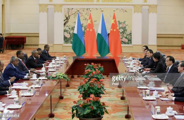 Chinese Premier Li Keqiang and Djibouti's President Ismail Omar Guelleh attend a meeting at the Great Hall of the People on November 24 2017 in...