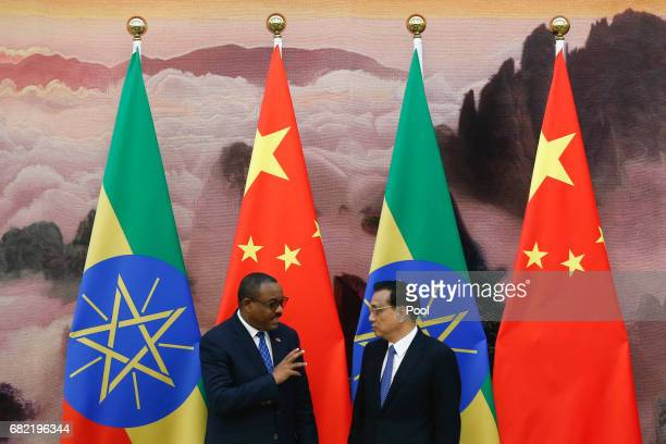 Chinese Premier Li Keqiang and Ethiopia's Prime Minister Hailemariam Desalegn attend a signing ceremony at the Great Hall of the People on May 12...