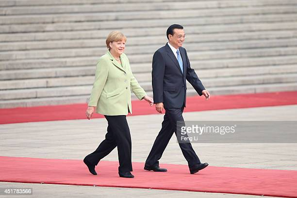 Chinese Premier Li Keqiang and German Chancellor Angela Merkel attend a welcoming ceremony outside the Great Hall of the People on July 7 2014 in...