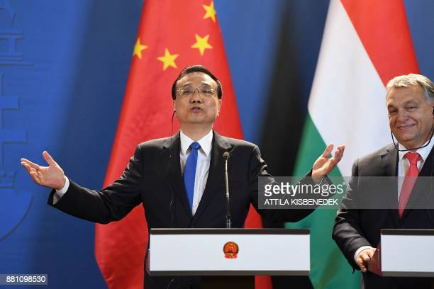 Chinese Premier Li Keqiang and Hungarian Prime Minister Viktor Orban address a press conference in the Hungarian parliament building in Budapest on...