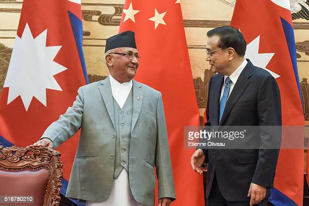 Chinese Premier Li Keqiang and Nepal Prime Minister Khadga Prasad Sharma Oli talk during a signing ceremony at the Great Hall of the People on March...