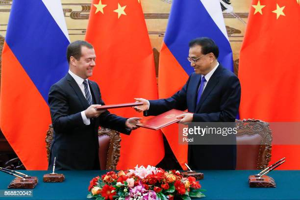Chinese Premier Li Keqiang and Russian Prime Minister Dmitry Medvedev attend a signing ceremony at the Great Hall of the People on November 1 2017 in...