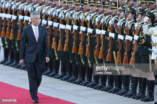 Chinese Premier Li Keqiang and Singapore Prime Minister Lee Hsien Loong view a guard of honour during a welcoming ceremony outside the Great Hall of...