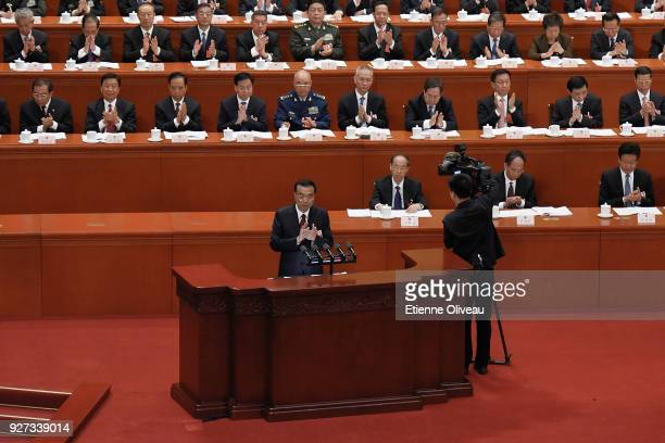 Chinese Premier Li Keqiang applauds during the opening session of the 13th National People's Congress at The Great Hall of People on March 5 2018 in...