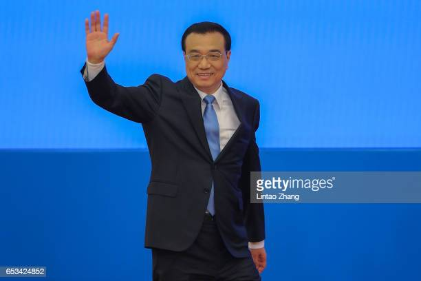 Chinese Premier Li Keqiang arrives at press conference after the closing of the Fifth Session of the 12th National People's Congress at the Great...